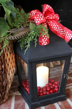 Christmas Lantern Decoration. Would love them along the front porch lighting the way to the door. Very welcoming.