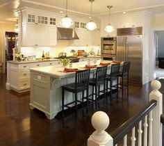Galley kitchen with island bar and mostly white details. contemporary kitchen by LDa Architecture & Interiors