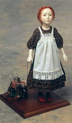 girl doll with toy elephant
