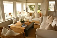 Coastal white slipcover furniture in beach house living room