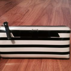 Patent Leather Black and White Stripe Bow Wallet Gorgeous wallet with 8 card slots, 2 compartments for cash or checks, and zip pocket for change. Patent leather means easy cleaning ( a damp wipe removes all gunk) and very durable! Adorable bow detail that will demand compliments! kate spade Bags Wallets