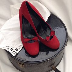 """kate spade Red Suede Pumps Good condition, red suede, front bow with black trim, thick square 3"""" heel with some wear marks on heels see last pic.  kate spade Shoes Heels"""