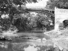 THE OLD BRIDGE, which spans the Rio Cobre at the eastern entrance to Spanish Town, is the focal point of this study of a tranquil, rural scene.  The old iron bridge in Jamaica, Spanish Town, St Catherine, today. This bridge, erected in 1801, at a cost of £4,000 is the oldest bridge of its kind in the Western Hemisphere - Norman Grindley/Chief Photographer