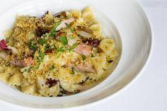 Grilled Bacon & Radicchio Farfalle - roasted garlic cream & lemon pepper crumbs — at Oliver & Bonacini Café Grill, Oakville.