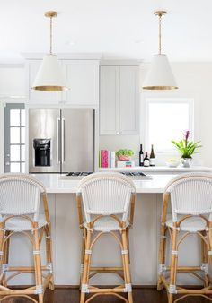 White kitchen with pendant lights and Serena