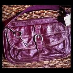 """New Purple Fossil """"Lisette"""" Handbag New with tags still attached! Canvas and leather """"Lisette"""" style Fossil purse in a beautiful eggplant purple. Zip top, classic silver tone key fob, GORGEOUS! Fossil Bags"""