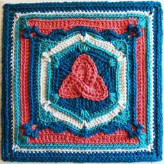 The central motif in this unusual block is a triquetra, an unbroken line forming three overlapping loops. It's a well-known and often-used shape in Celtic culture, and any number of meanings have been ascribed to it over the centuries. The mystique surrounding this shape continues to this day. This intermediate level pattern makes use of foundation double crochet and non-standard stitch placement, such as long stitches worked into previous rounds, and working into the back bar (the loop…