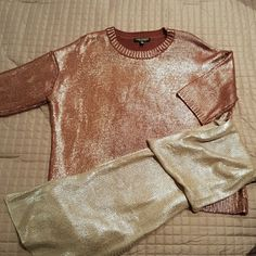 Shimmering Bronze Sweater with Silver Scarf Short sleeved, oversized (not fitted) sweater.  100 % acrylic.  Very shimmering fabric in elegant bronze color. I have included a  silver, neck  scarf made of the same type sweater fabric. Excellent condition. No sweater snags. A glamorous piece for your Holiday parties! Sweaters
