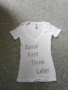 """Dance First Think Later. Stand out in the crowd at conventions, workshops or auditions in the super soft v neck fitted tee from Next Level Apparel. Silk screened words- Dance First Think Later. From Contemporary Dance Apparel, sizes small, medium and large.    -Model is 5'9"""" 115lbs and is wearin..."""
