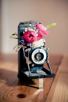 Why not turn a vintage camera into a flower vase?? Cool