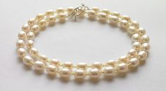 Freshwater pearls and peridot gemstone beads Single strand necklace from Not Just Red Ones.