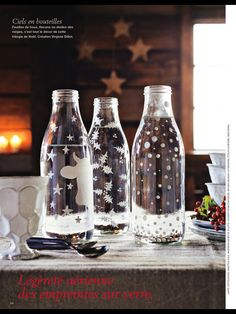 Glass bottles painted with snowflakes, stars . Nice for on the x-mas table!