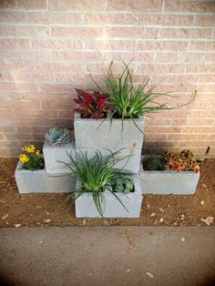 Summer style!! DIY!! Easy cinder block planter - just stack and fill!! Use these everywhere!!