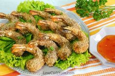 A delicious low carb and gluten free coconut shrimp recipe with a crispy seasoned coating. It's a perfect appetizer for any party or game day!