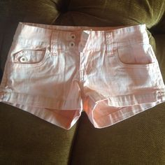 Orange shorts These shorts are a pretty peach orange color and I love them. They are a great style for summer and I'm so sad I do not fit in them anymore! Highly recommend:) YMI Shorts Jean Shorts
