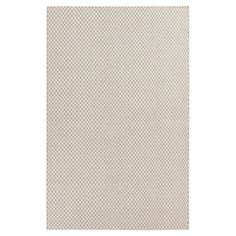 Tie together a traditional space or anchor vibrant decor with this handmade wool rug, showcasing a petite trellis motif in taupe and winter white.