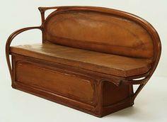 Settee, 1897, Seu trabalho com o mobiliário tambem incluia os motivos florais do Art Nouveau, caracterizando o objeto com elementos que o elev...