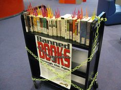 Burning banned books - Banned Books Week book cart display - Jacksonville Public Library