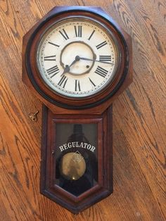 Antique Ansonia Clock Co. Wall Clock Large Octagon Drop Glass is original and in great condition The dial is also original and in great condition Has original key and pendulum I turned the key and it