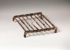 Iron fire-grate. Period: Archaic. Date: ca. 550 B.C. Culture: Etruscan