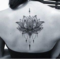 women lotus tattoo on back