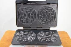 http://www.ebay.com/itm/Villaware-5-Pizzelle-Maker-Uno-Series-Italian-Cookie-Waffle-Baker-Model-2060-/191814623314?hash=item2ca90ae052:g:qEcAAOSw~OVW0XAu