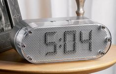Daka Designs Pin Clock. The Pin Clock contains 3,000 pins that lift and retract to display the hour and minutes.