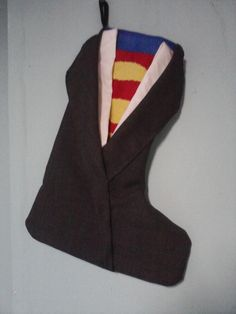 Clark Kent is Superman Christmas Stocking. $15.00, via Etsy. Hmmm... Maybe I could make everyone a different Superhero stocking.