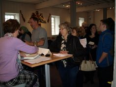 Pauline Rowson signing copies of her crime novels at CSI Portsmouth 2013