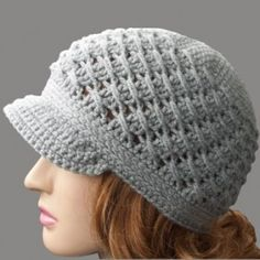 This cross-over long dc free crochet newsboy hat pattern features a beautiful sprial texture along the sides of the hat. Crochet it with or without a brim. Crochet Newsboy Hat, Crochet Adult Hat, Bonnet Crochet, Crochet Cap, Crochet Amigurumi, Diy Crochet, Crochet Crafts, Double Crochet, Crochet Stitches