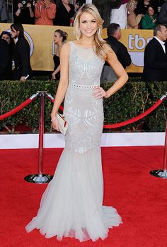 Brides.com: The Best Dresses from the 2013 SAG Awards. Katrina Bowden at the 2013 SAG Awards. 30 Rock's run is almost over, but Bowden's incredible  Badgley Mischka dress definitely signals the beginning of a beautiful style journey. The gown's art deco detailing, sheer neckline and fluttering hem, all in a soft light gray, are perfect for a wedding with vintage flair. (Perhaps this bride-to-be is giving us a hint about her upcoming wedding day style!)  Browse Badgley Mischka Bride wedding…