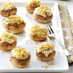 Artichoke Mushroom Caps Recipe -These crumb-topped appetizers never last long at parties. The rich filling of cream cheese, artichoke hearts, Parmesan cheese and green onion is terrific. You can broil them in your oven to enjoy any time of year. —Ruth Lewis, West Newton, Pennsylvania Recipes Appetizers And Snacks, Appetizer Dips, Yummy Appetizers, Appetizers For Party, Snack Recipes, Cooking Recipes, Mushroom Appetizers, Fruit Recipes, Vegetables