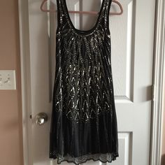 NWOT beaded dress Absolutely stunning, flowy beaded black and gold dress. Lightweight and comfortable. Angie Dresses Mini