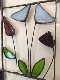 A handmade stained glass panel, framed in textured clear glass and pale blue and rich purple glass. The centre section is made in glass and wire and shows some blue poppies and other flowers. The panel measures by and has a grey velvet ribbon for hanging. Harvest Moon, Stained Glass Flowers, Stained Glass Windows, Stained Glass Patterns Free, Flower Window, Blue Poppy, Window Hanging, Purple Glass, Velvet Ribbon