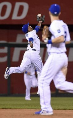 Kansas City Royals shortstop Alcides Escobar (2) snags an out on Seattle Mariners' James Jones in the ninth inning during Wednesday's baseball game on September 23, 2015 at Kauffman Stadium in Kansas City, Mo.
