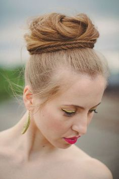 Romantic top knot with a twisted braid wrapped detail