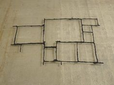 Cornelia Parker / Image of: Pavement Cracks (City of London) / mould of cracks in pavement recast in bronze.