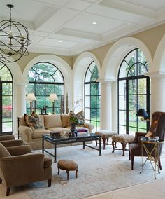 A soft blue and brown Turkish wool rug defines the seating area and allows the eye to go beyond the interior to the beautiful exterior. Photo by Beth Singer. Serba Interiors Kevin Serba - Birmingham, MI