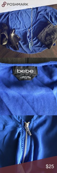 Bebe Royal Blue Pullover w/Zipper Like new! No rips or stains. Great Pullover top. Hangs loose and flows. bebe Tops