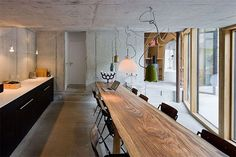 killer table in underground house in vals, switzerland.  house built by SeARCH and christian muller architects