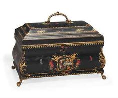 A GEORGE III POLYCHROME-JAPANNED TOLE TEA CADDY  CIRCA 1760  Of bombé form, decorated with floral sprays, butterflies and a coat of arms applied to the back and front, with brass handle and feet