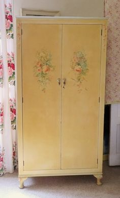 Antique decorative wardrobe hand painted roses and floral sprays. Beautiful items here.