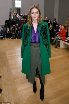 Driving fans green with envy: The American model, 31, clashed textures and patterns in a b...