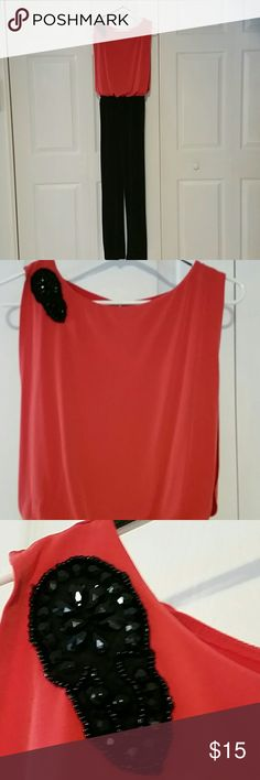 "Outfit Coral/black one piece, polyester spandex measures 56"" from shoulder to ankle, inseam 28"" Other"