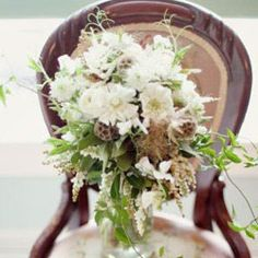 very wild and natural looking! scabiosa flower and pods, sweet peas, astilbe, and jasmine vine, by Emily Herzig