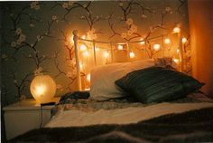 Cherry blossom walls and christmas lights. Let's cuddle.
