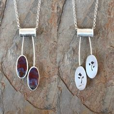 I have cut and set two 20mm x 10mm Polka Dot Agate cabochons in fine silver.  The pendant measures 2.25 by 0.75 in total and hangs from an 18 sterling silver chain which can be worn up to 20    I design and make all of my jewelry in my home studio in Texas.  All I make goes to charity - see coldfeetstudio.com and click the Giving Back tag  All my jewelry is hand formed using one or more of the following: Fine silver, Sterling silver, Thai silver, pmc (precious metal clay), copper, brass…