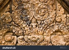 Image from http://image.shutterstock.com/z/stock-photo-ancient-khmer-lintel-carved-with-a-kala-demon-figure-sitting-on-top-of-two-makaras-sea-serpents-98842571.jpg.