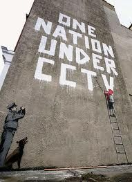"""One Nation Under CCTV"" - Banksy piece, Newman Street, near Oxford Circus, London.  http://www.roehampton-online.com/About%20Us/Roehampton%20London.aspx?4231900"