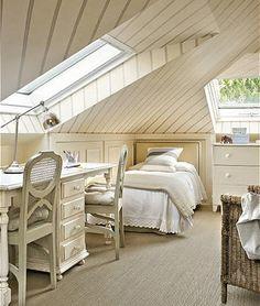 Crisp white attic. Nice use of diagonal stripes on ceiling